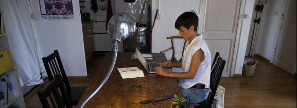 A woman consulting her laptop at home