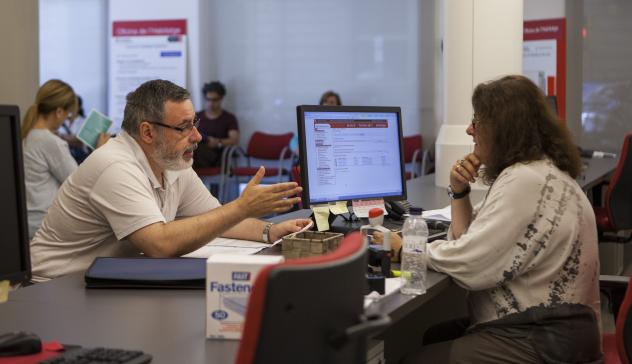 A man making an enquiry at a municipal office